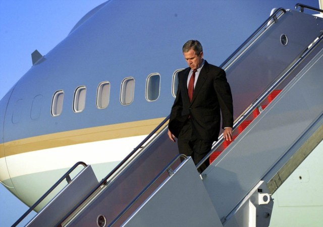 ANDREWS AIR FORCE BASE, MD - SEPTEMBER 11: US President George W. Bush walks down the steps of Air Force One as he arrives at Andrews Air Force Base 11 September 2001 in Maryland. Bush will address the nation from the Oval Office on the terrorist attacks at the World Trade Center and the Pentagon. (Photo credit should read DOUG MILLS/AFP/Getty Images)