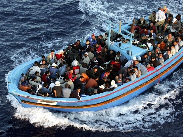 LAMPEDUSA, ITALY - JUNE 21:  A boat loaded with illegal immigrant is seen on  June 21, 2005 in Lampedusa, Italy. Tens of thousands of immigrants land on the Italian coast each year, most of them heading from north Africa on ramshackle boats.In the Mediterranean Sea between Malta and Tunisia, Lampedusa Island is one of the main gateways for illegal immigration from Africa into Europe. According to a report by Amnesty International, Illegal immigrants who land in Italy consistently allege they have been abused, holding centres are overcrowded and no legal assistance is offered. Italian authorities refused to give access to the centres to enable further investigations by Amnesty. The Amnesty International report says 15,647 people were held in the centres in 2004: a 9 per-cent increase on the previous year. (Photo by Marco Di Lauro/Getty Images)