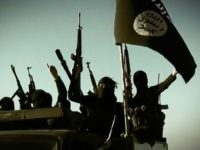 An image taken from a propaganda video released on March 17, 2014 by the Islamic State group's al-Furqan Media allegedly shows fighters raising their weapons as they stand on a vehicle mounted with the trademark jihadists flag