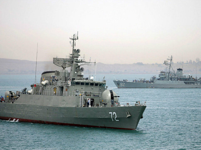 "In this picture taken on Tuesday, April 7, 2015, and released by the semi-official Fars News Agency, Iranian warship Alborz, foreground, prepares before leaving Iran's waters. Iran dispatched a naval destroyer and another logistic vessel, Wednesday to waters near Yemen as the United States quickened weapons supply to the Saudi-led coalition striking rebels there, underlining how foreign powers are deepening their involvement in the conflict. Iran's English-language state broadcaster Press TV quoted Rear Adm. Habibollah Sayyari as saying the ships would be part of an anti-piracy campaign ""safeguarding naval routes for vessels in the region."" (AP Photo/Fars News Agency, Mahdi Marizad)"