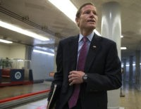 Sen. Richard Blumenthal, D-Conn., and other senators head to the chamber to vote as a rescue package for debt-stricken Puerto Rico survived a critical procedural test vote, just two days before the island is expected to default on a $2 billion debt payment, on Capitol Hill in Washington, Wednesday, June 29, 2016. The White House-backed measure would create a control board that would oversee the U.S. territory's finances and could supervise some debt restructuring. Senators voted 68-32 to advance the bill to a final vote as leaders of both parties urged their colleagues to support the legislation.  (AP Photo/J. Scott Applewhite)
