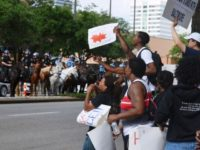 BLM-8-Protesters-stand-off-against-mounted-cops