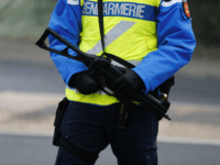 A French gendarme armed with a Heckler and Koch UMP stands guard during a road traffic control in Martainville-Epreville, Normandy, northwestern France, on December 30, 2016.