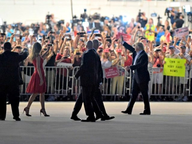 """President Donald Trump, second from right, and first lady Melania Trump, third from left, wave to the crowd following the """"Make America Great Again Rally"""" at Orlando-Melbourne International Airport in Melbourne, Fla., Saturday, Feb. 18, 2017. (AP Photo/Susan Walsh)"""