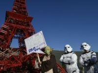 Avaaz activists protest during the COP21 United Nations climate conference