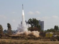 "In this July 9, 2014 file photo, an Iron Dome air defense system fires to intercept a rocket from the Gaza Strip in Tel Aviv, Israel. Israel's ""Iron Dome"" defense system has emerged as a game-changer in the current round of violence with Hamas militants in the Gaza Strip, shooting down dozens of incoming rockets and being credited with preventing numerous civilian casualties. The system is ensuring Israel's decisive technological edge that has helped it operate virtually unhindered in Gaza. (AP Photo/Dan Balilty, File)"