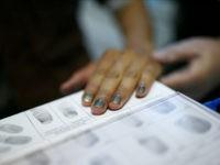 Fingerprints of a migrant are taken during registration at the Patrick-Henry Village refugee center, a former U.S. military facility in Heidelberg, Germany, September 29, 2015. REUTERS/Ralph Orlowski