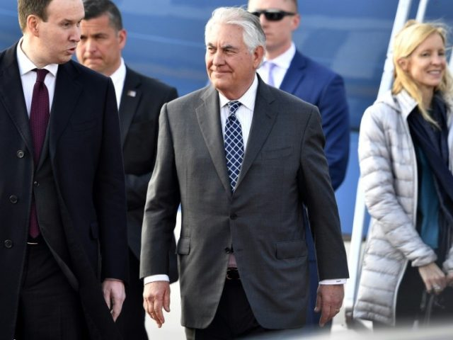 US Secretary of State Rex Tillerson (C) walks upon his arrival at the Vnukovo II Government airport in Moscow on April 11, 2017