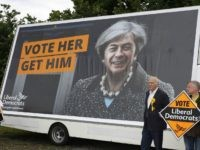 Liberal Democrat politician Vince Cable poses for a photograph after unveiling a campaign poster featuring a combined image of Nigel Farage and Theresa May at Twickenham Rugby Football Club in south west London on May 20, 2017. Cable, former Liberal Democrat Shadow Chancellor and former Business Secretary is looking to regain the Twickenham seat in the upcoming general election. / AFP PHOTO / ADRIAN DENNIS (Photo credit should read ADRIAN DENNIS/AFP/Getty Images)
