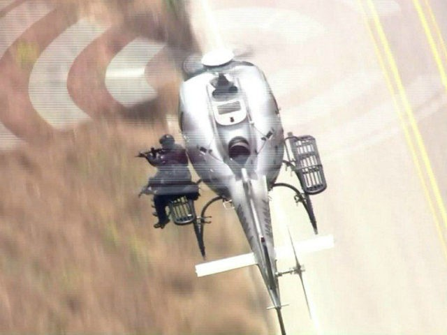 Video has emerged of LAPD Swat officers shooting from a helicopter and killing an armed home invasion suspect on Monday.