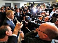 Republican presidential candidate Donald Trump talks with reporters as he arrives to speak at a No Labels Problem Solver convention, Monday, Oct. 12, 2015, in Manchester, N.H. (AP Photo/Jim Cole)