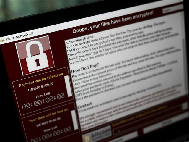 A lock screen from a cyber attack warns that data files have been encrypted on a laptop computer in this arranged photo in London, U.K., on Monday, May 15, 2017. Governments and companies around the world began to gain the upper hand against the first wave of an unrivaled global cyberattack, even as the assault was poised to continue claiming victims this week. Photographer: Simon Dawson/Bloomberg via Getty Images