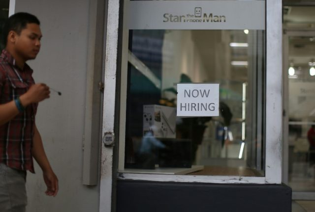 New claims for jobless benefits sank at the end of April, and the total number of people receiving unemployment benefits hit a 17-year low