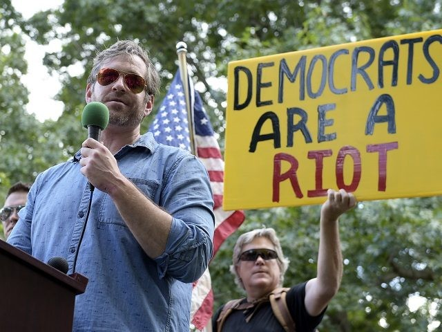 """Mike Cernovich, left, a right-wing author and attorney, speaks during a rally outside the White House in Washington, Sunday, June 25, 2017. Cernovich was one of many speakers at the """"Rally Against Political Violence,"""" that was to condemn the attack on Republican congressmen during their June 14 baseball practice in Virginia and the """"depictions of gruesome displays of brutality against sitting U.S. national leaders."""" (AP Photo/Susan Walsh)"""