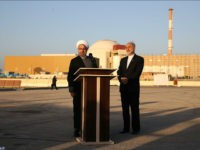 In this photo released by the Iranian Presidency Office, President Hassan Rouhani, left, speaks as he is accompanied by the head of Iran's Atomic Energy Organization Ali Akbar Salehi during his visit to the Bushehr nuclear power plant just outside the port city of Bushehr, southern Iran, Tuesday, Jan. 13, 2015. (AP Photo/Iranian Presidency Office, Mohammad Berno)