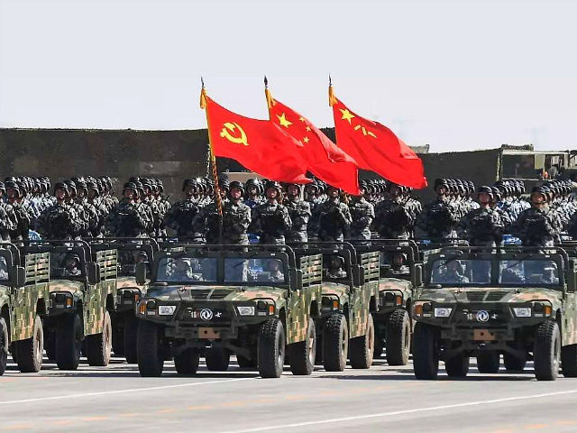 XILINGOL, CHINA - JULY 30: The flag guard formation holding the flag of the Communist Party of China, the national flag and the flag of the PLA attends a military parade at Zhurihe military training base to mark the 90th birthday of Chinese People's Liberation Army (PLA) on July 30, 2017 in Xilingol League, Inner Mongolia Autonomous Region of China. China held on Sunday its first Army Day parade one day before the 90th birthday of PLA. (Photo by Cui Nan/CHINA NEWS SERVICE/VCG via Getty Images)