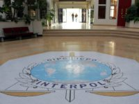 FILE - This Oct.16, 2007 file photo shows the entrance hall of Interpol's headquarters in Lyon, central France. International police agency Interpol has voted Wednesday Sept.27, 2017 to include the