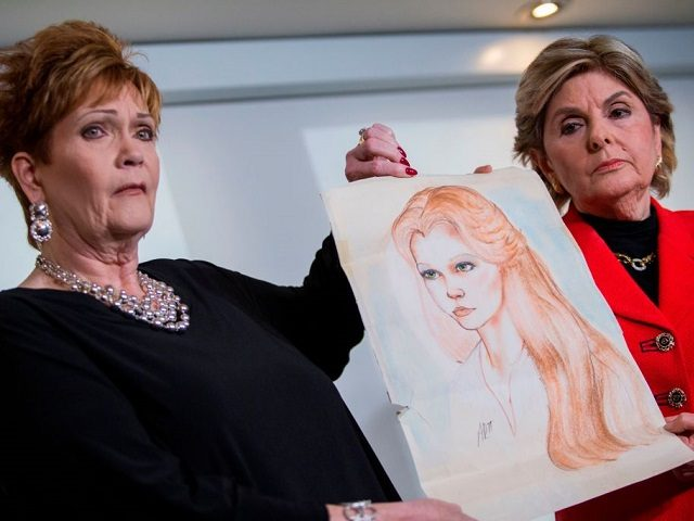 Attorney Gloria Allred (R) and Beverly Young Nelson hold up a drawing of Nelson when she was younger during a press conference on November 13, 2017, in New York, alledging that Roy Moore sexually assaulted Nelson when she was a minor in Alabama without her consent. The US Senate's top Republican on Monday urged scandal-hit conservative Roy Moore to end his Senate campaign, saying he believes the women who have accused the Christian evangelical candidate of sexual misconduct. / AFP PHOTO / EDUARDO MUNOZ ALVAREZ (Photo credit should read EDUARDO MUNOZ ALVAREZ/AFP/Getty Images)