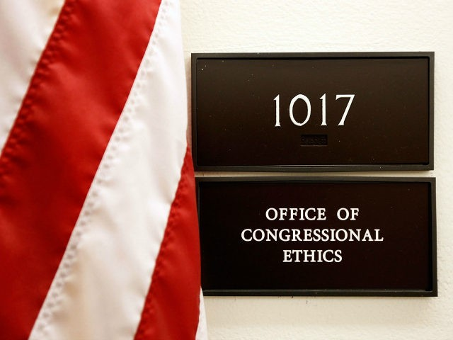 A sign for the Office of Congressional Ethics hangs on a wall October 30, 2009 in Washington, DC. A document from the House of Representatives ethics committee inadvertently placed on a publicly accessible computer network outlined investigations into the activities of 30 lawmakers from the House. The 22-page document, titled 'Committee on Standards Weekly Summary Report,' was discovered on a file-sharing computer server and also outlined investigations by the Office of Congressional Ethics, a quasi-independent body that initiates investigations and provides recommendations to the ethics committee. (Photo by Chip Somodevilla/Getty Images)