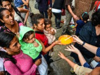 Hunger in Venezuela has worsened, non-governmental organizations and the Catholic Church have held food aid days to help people and children living on the streets or in extreme poverty in Caracas, Venezuela on 30 November 2017. (Photo by Roman Camacho/NurPhoto via Getty Images)