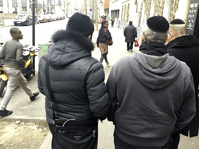 Members of French Jewish community walk in a street of Paris, Wednesday, Feb. 22, 2017. If far-right candidate Marine Le Pen wins the upcoming presidential election, she plans to ban religious symbols from French streets, which would impact on Jews who would no longer be allowed to wear their kippa head-coverings, and Muslims who would no longer be allowed to wear headscarfs in public which may dramatically alter the country's urban landscape. (AP Photo/Jeffrey Schaeffer)