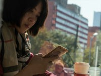 A woman uses her smartphone in Beijing on November 11, 2017. China's smartphone masses splurged billions of dollars in an e-commerce bonanza on November 11 as consumers rushed to snap up bargains on 'Double 11', billed as the world's biggest one-day online shopping festival. / AFP PHOTO / FRED DUFOUR (Photo credit should read FRED DUFOUR/AFP/Getty Images)
