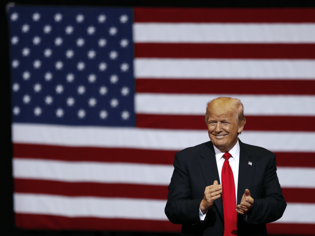 President Donald Trump smiles at supporters as he arrives to speak at a rally, Wednesday, June 21, 2017, in Cedar Rapids, Iowa. (AP Photo/Charlie Neibergall)