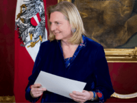 Austrian Foreign minister Karin Kneissl holds her letter of appointment during the inauguration ceremony of the new Austrian government at the Hofburg in Vienna, Austria, on December 18, 2017. Austria's president swore in Sebastian Kurz as head of a new coalition government involving Kurz's conservatives and the far-right, capping a year of successes for Europe's nationalists. / AFP PHOTO / VLADIMIR SIMICEK (Photo credit should read VLADIMIR SIMICEK/AFP/Getty Images)