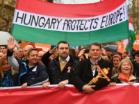 Demonstrators hold a flag in the colors of Hungary reading 'Hungary protects Europe' as they arrive to listen to a speech of their Prime Minister in Budapest on March 15, 2018, as celebrations are under way to commemorates the 170th anniversary of the 1848-1849 Hungarian revolution and independence war on Hungary's National Day. Hungarians took to the streets in separate national day demonstrations to both voice support for, and protest against, Prime Minister Viktor Orban, as an election April 8, 2018 nears. / AFP PHOTO / ATTILA KISBENEDEK STF (Photo credit should read ATTILA KISBENEDEK STF/AFP/Getty Images)