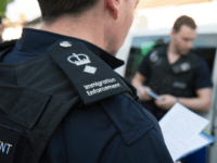 LONDON, UNITED KINGDOM - MAY 21: Immigration enforcement officers raid a home in Southall on May 21, 2015 in London, England. Despite pledging in 2010 to reduce migration numbers to less than 100,000, new immigration figures reveal that net migration to the UK reached 318,000 last year, the highest in a decade, increasing more than 50% in 2014. The Prime Minister has today unveiled measures to tackle illegal immigration, which include seizing wages. (Photo by Laura Lean - WPA Pool/Getty Images)
