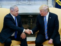 US President Donald Trump shakes hands with Israel's Prime Minister Benjamin Netanyahu in the Oval Office of the White House on March 5, 2018 in Washington, DC. President Donald Trump said he 'may' attend the opening of a controversial new US embassy in Jerusalem, a fraught prospect designed to underscore close ties with Benjamin Netanyahu, whom he hosted Monday.Trump warmly welcomed the embattled prime minister to the White House, claiming US-Israel ties had 'never been better' and floating a May trip that would be a major security and diplomatic challenge. / AFP PHOTO / MANDEL NGAN (Photo credit should read MANDEL NGAN/AFP/Getty Images)