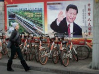 A propaganda poster showing China's President Xi Jinping is pictured on a wall in Beijing on March 12, 2018. China's Xi Jinping on March 11 secured a path to rule indefinitely as parliament abolished presidential term limits, handing him almost total authority to pursue a vision of transforming the nation into an economic and military superpower. / AFP PHOTO / NICOLAS ASFOURI (Photo credit should read NICOLAS ASFOURI/AFP/Getty Images)