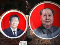 In this March 1, 2016 file photo, souvenir plates bearing images of Chinese President Xi Jinping, left, and late Chinese leader Mao Zedong are displayed at a shop near Tiananmen Square in Beijing. In 2016, the Chinese Communist Party bestows on Xi the wholly ceremonial yet highly significant title of