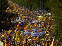 Demonstrators wave esteladas or independence flags in Barcelona, Spain, Sunday, April 15, 2018, during a protest in support of Catalonian politicians who have been jailed on charges of sedition. Tens of thousands of Catalan separatists rallied in downtown Barcelona Sunday to demand the release of high-profile secessionist leaders being held in pre-trial detention. (AP Photo/Emilio Morenatti)