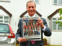 WESTERHAM, ENGLAND - JUNE 23: Nigel Farage, leader of UKIP and Vote Leave campaigner holds up the 'Daily Express' as he returns to his home after buying newspapers of the United Kingdom on June 23, 2016 in Westerham, England. The United Kingdom is going to the polls to decide whether or not the country wishes to remain within the European Union. After a hard fought campaign from both REMAIN and LEAVE the vote is too close to call. A result on the referendum is expected on Friday morning. (Photo by Mary Turner/Getty Images)