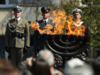 Polish soldiers attend the main commemoration ceremony of the 75th anniversary of the Warsaw Ghetto Uprising on April 19, 2018 in Warsaw, Poland. The Warsaw Ghetto was a prison created by the German military during its occupation of Warsaw during World War II. Starting in 1940, 400,000 Jews were confined to a walled-in neighborhood of 3.4 square kilometers under horrific conditions. With assistance from Polish partisans the Jews rose up in armed resistance in 1943 and held off the Germans for several weeks until the Germans annihilated the ghetto, killing 13,000 people. In all 392,000 Jews from the Warsaw ghetto were killed, most of them after deportation to the Treblinka death camp. (Photo by Sean Gallup/Getty Images)