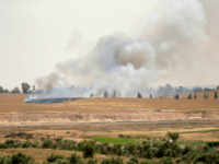 Smoke and flames rise from fields near the Kibbutz Beeri on the Israeli side of the border with the Gaza Strip east of Gaza City, after Palestinians flew a kite laden with a molotov cocktail over the border before cutting the string leaving the burning material to fall in Israeli territory on April 17, 2018. / AFP PHOTO / MAHMUD HAMS (Photo credit should read MAHMUD HAMS/AFP/Getty Images)