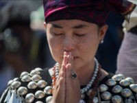 A woman wearing traditional dress from Kachin state in Myanmar sheds a tear as she prays outside St. Mary's Cathedral during a mass led by Pope Francis in Yangon during his last day of a four-day visit on November 30, 2017. Pope Francis on November 30 wrapped up a visit to Myanmar defined by his decision not to address the Rohingya crisis in public, before flying to Bangladesh, where huge numbers of refugees from the Muslim minority languish in refugee camps. / AFP PHOTO / Roberto SCHMIDT (Photo credit should read ROBERTO SCHMIDT/AFP/Getty Images)