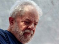 Brazilian ex-president (2003-2011) Luiz Inacio Lula da Silva, seen gesturing during a Catholic mass in memory of his late wife Marisa Leticia on April 7, 2018, has begun serving a 12 year sentence for corruption