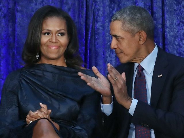 Former U.S. President Barack Obama and first lady Michelle Obama participate in the unveiling of their official portraits during a ceremony at the Smithsonian's National Portrait Gallery, on February 12, 2018 in Washington, DC. The portraits were commissioned by the Gallery, for Kehinde Wiley to create President Obama's portrait, and …