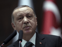 "Turkish President Recep Tayyip Erdogan addresses the members of his ruling party at the parliament in Ankara, Turkey, Tuesday, March 20, 2018. Erdogan has called on the United States to ""show respect"" and ""walk with"" its NATO ally, in new criticism of Washington over its engagement with Syrian Kurdish militia. Erdogan's comments on Tuesday were in reply to statements from the U.S. State Departments voicing concern over Turkey's cross border offensive in northwestern Syrian enclave of Afrin, which Turkish troops and allied Syrian forces captured from the Syrian militia on Sunday.(AP Photo/Burhan Ozbilici)"