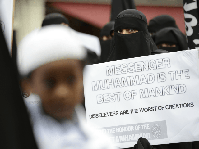 Muslim protesters hold signs as they demonstrate against a French magazine that published nude cartoons of the Prophet Mohammed outside the French embassy in London on September 21, 2012. Around 100 protesters shouted slogans outside the French embassy in London over the cartoons at the same time as violent demonstrations …
