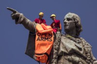The Latest: Columbus statue protest over migrant deaths