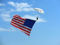 WATKINS GLEN, NY - AUGUST 05: A sky diver displays an American flag prior to the start of the Monster Energy NASCAR Cup Series GoBowling at The Glen at Watkins Glen International on August 5, 2018 in Watkins Glen, New York. (Photo by Robert Laberge/Getty Images)