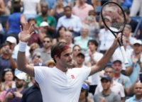 Victory salute: Roger Federer celebrates victory against Benoit Paire