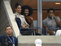 Former NFL players Colin Kaepernick (center) and Eric Reid (right) attends US Open match between Serena and Venus Williams on Friday.