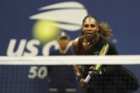 On song: Serena Williams on the way to a US Open third-round victory over her sister Venus on Friday.
