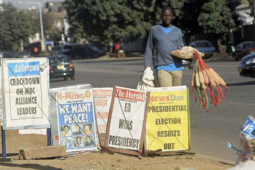 The Latest: Zimbabwe police break up opposition event - Breitbart