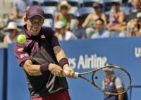 The Latest: Nishikori into quarterfinals in US Open return