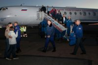 In this handout picture released by Russia's space agency Roscosmos, NASA astronaut Nick Hague and Russian cosmonaut Alexey Ovchinin are welcomed by family members and officials after landing at the Krayniy Airport in Baikonur, Kazakhstan
